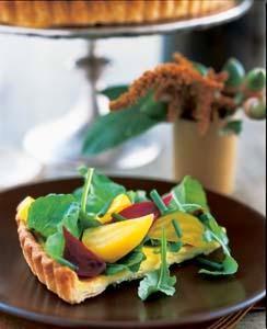 http://deliciousliving.com/recipes/goat-cheese-tart-marinated-beets-and-arugula-0